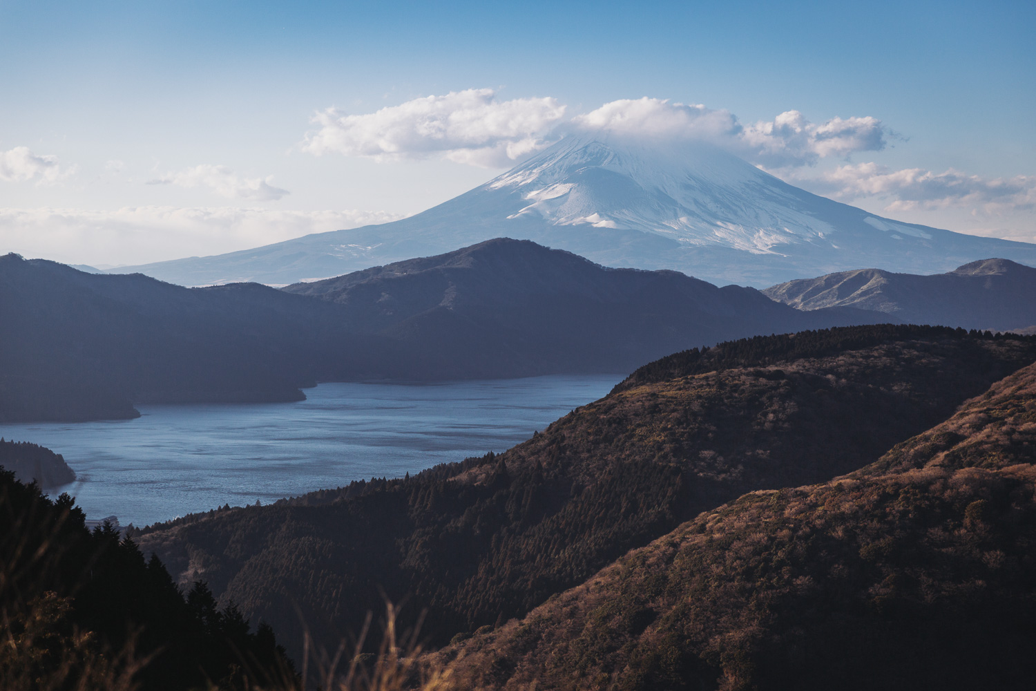 Mount Fuji and surrounding mountains in the late-day January sun over Lake Ashi, Hakone, Japan