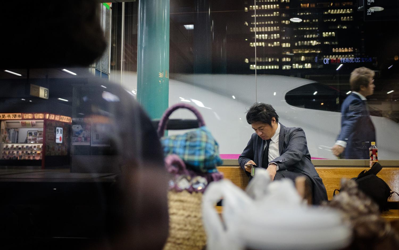 Salaryman and an E2 Series Nagano Shinkansen bullet train at Tokyo Station, Japan