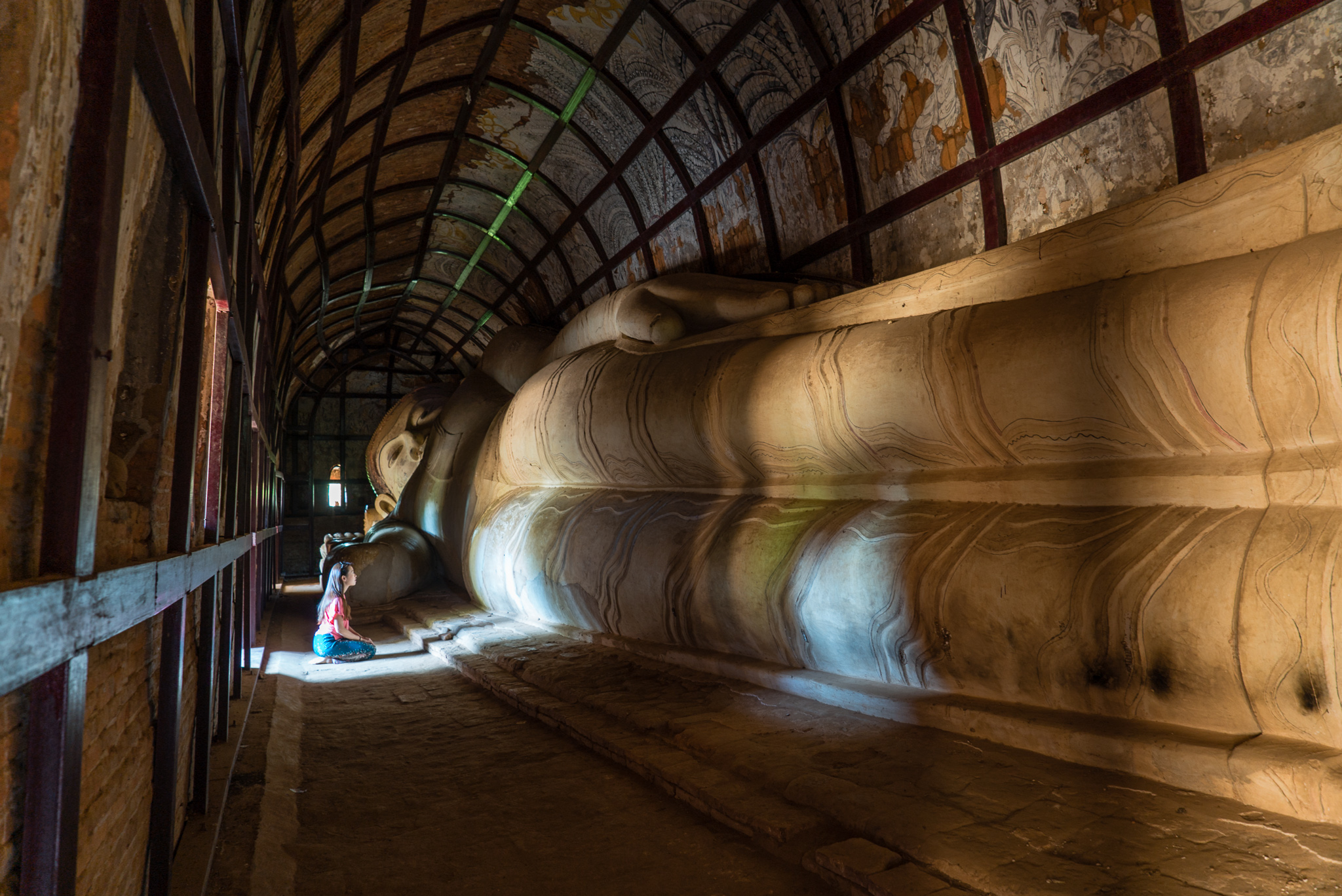 The second largest 18-metre long reclining Buddha sculpture in Bagan, a surprise find in the seemingly small brick structure around the Shwesandaw compound.