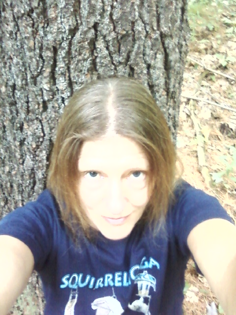 """Here I am, getting a """"life force"""" infusion from the same favored white pine! I often sit here, my spine hugging this white pine, contemplating life."""