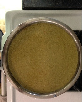 """The cake batter in a 9"""" pan looking a bit olive drab green not the bright green of  Kate from the UK's cake ,            See # 5 & # 11 above explaining pan size difference and cake color difference."""
