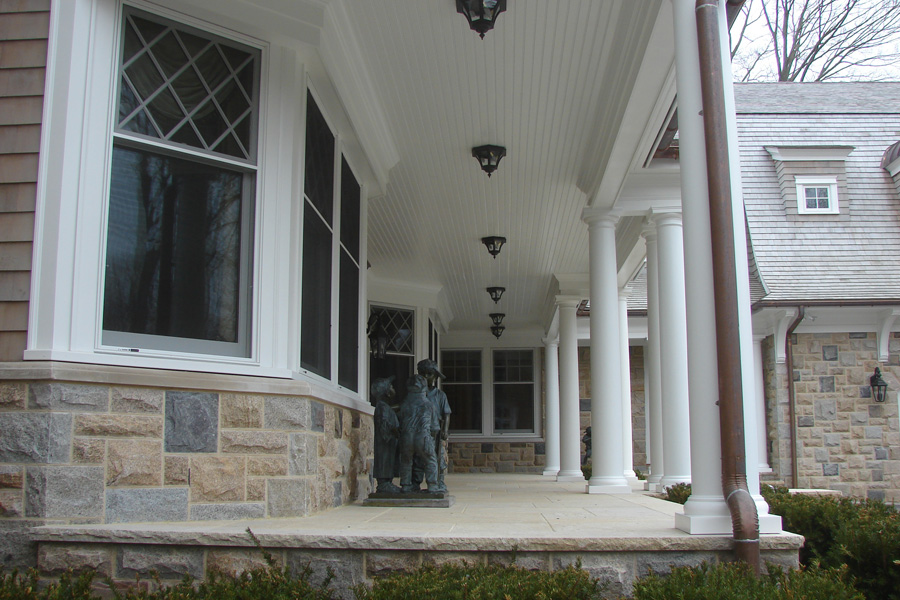 cove-neck-covered-porch-stone.jpg