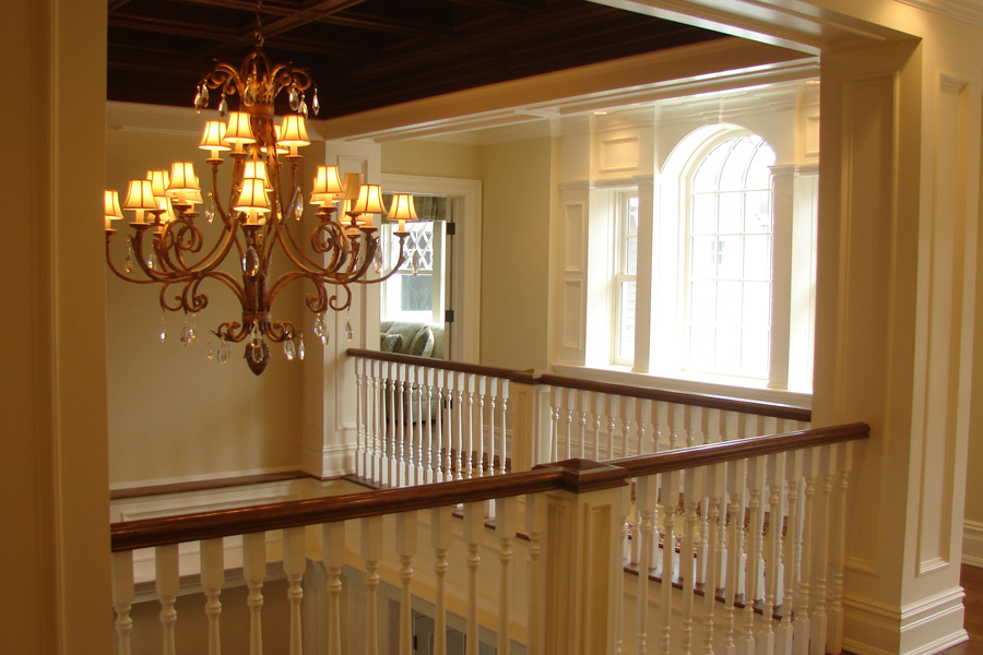 cove-neck-staircase-landing-railing.jpg