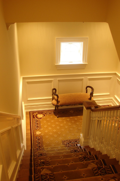 cove-neck-staircase-wainscoted.jpg