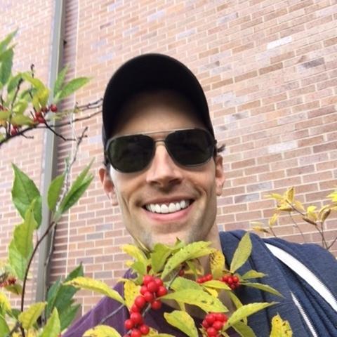 Robert Z. Grant amongst berries.