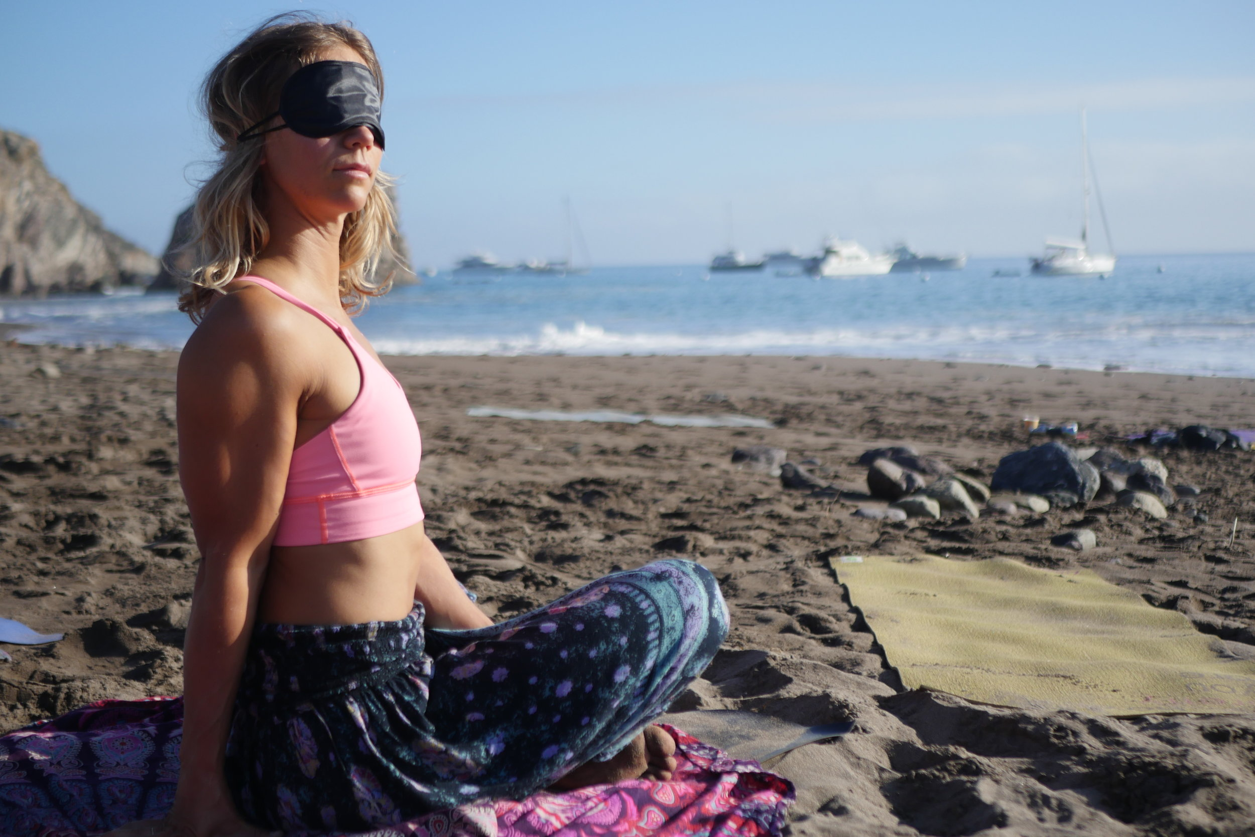 Getting our morning BLINDFOLDED yoga time in on the beach. Not being able to see provides gratitude for what we have and challenges our senses and balance so much.