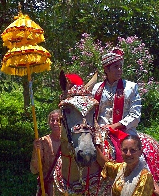 For the Baraat, celebrate the grooms arrival in full glory -