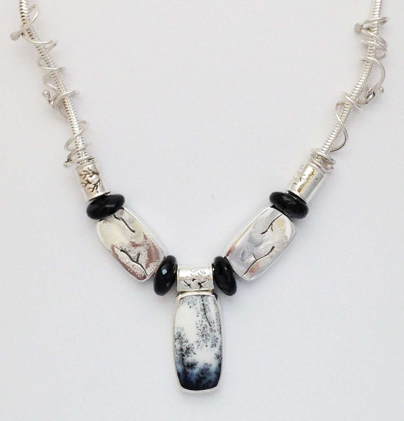 Carol's every changing necklace- sterling silver, snow globe agate and onyx