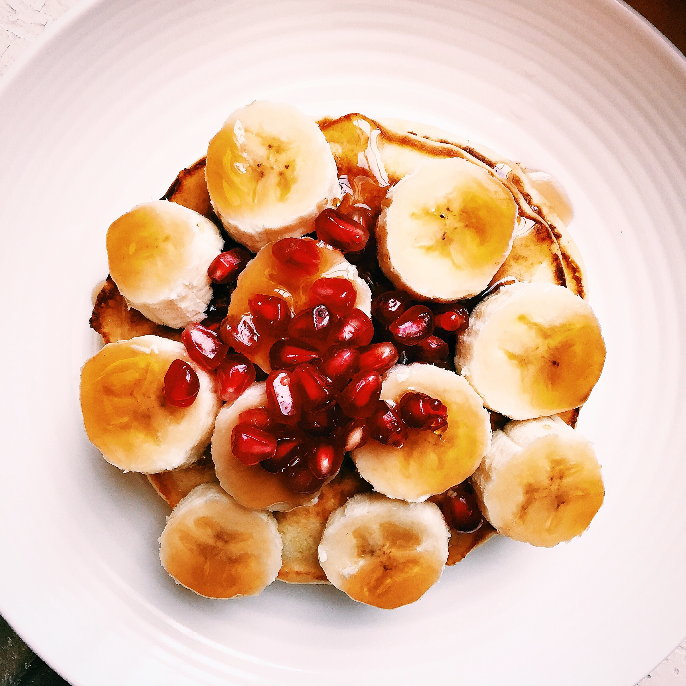 First Breakfast of the New Year: pancakes with bananas and pomegranate seeds