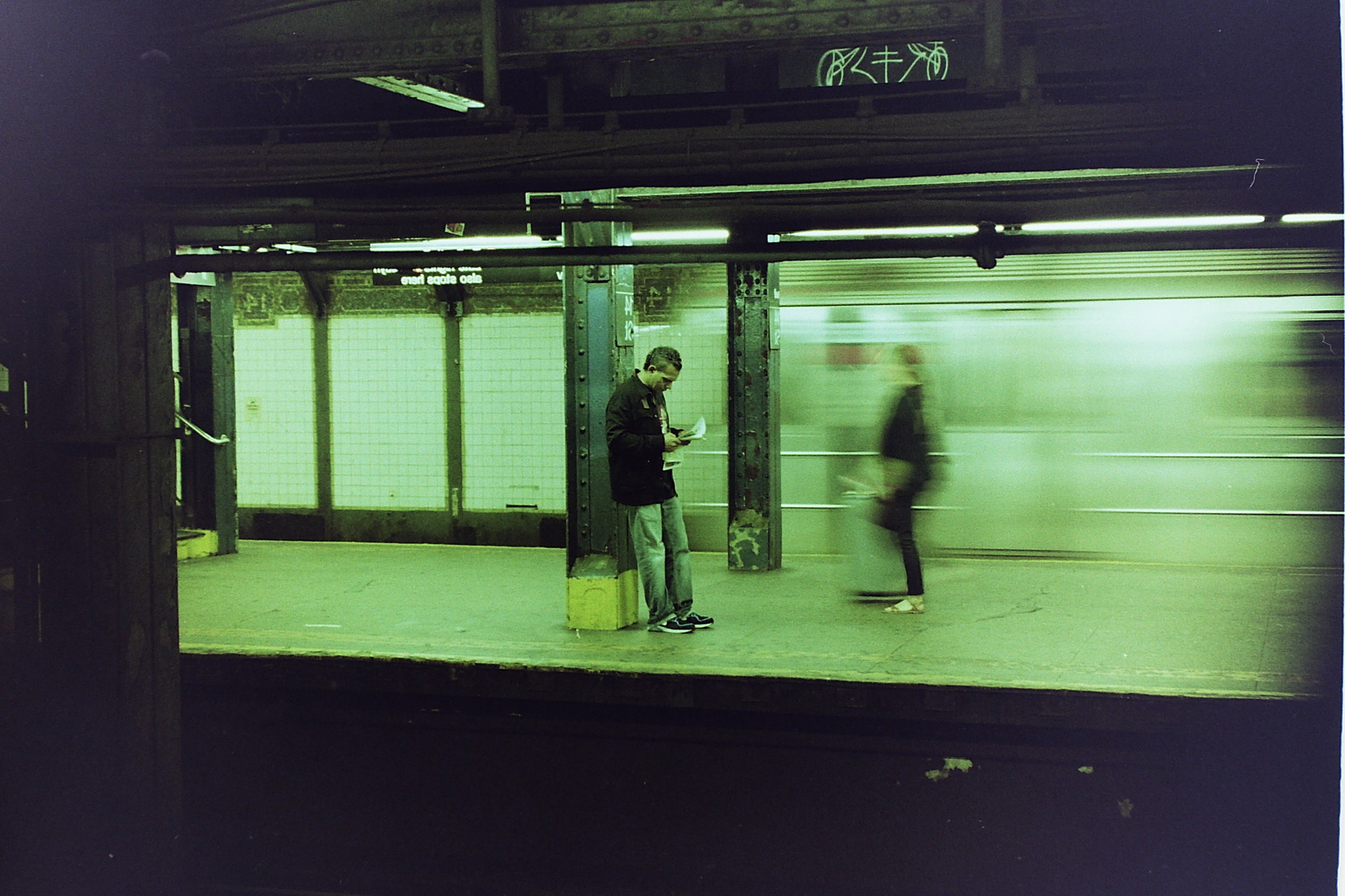 #4 Some Random Subway Station // New York City  I can't remember which station this was taken in, but I guess that doesn't really matter. I snapped this on Lomography film as a train was leaving the station- I love the juxtaposition of the chaotic, NYC-feeling look of the moving train/woman walking through the station with the stillness of the man reading the newspaper. If you're reading this, newspaper man, thank u for being chill. (I also feel like I should note that I was in New York to receive my Scholastic Award, but I might sounds like a broken record by now).