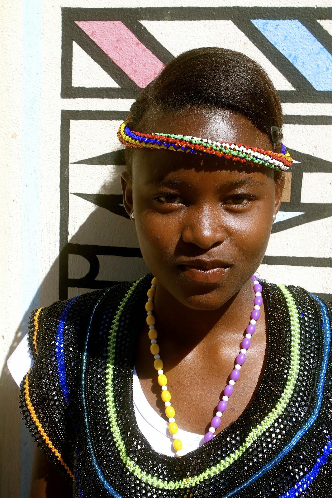 This is one of my grade eight learners, Maria. We went on field trip with the school choir to the Ndebele king's wedding. The choir waited around for hours to sing, but never got the chance. Instead, a few of my girls, Maria included, turned the experience into a photo shoot.
