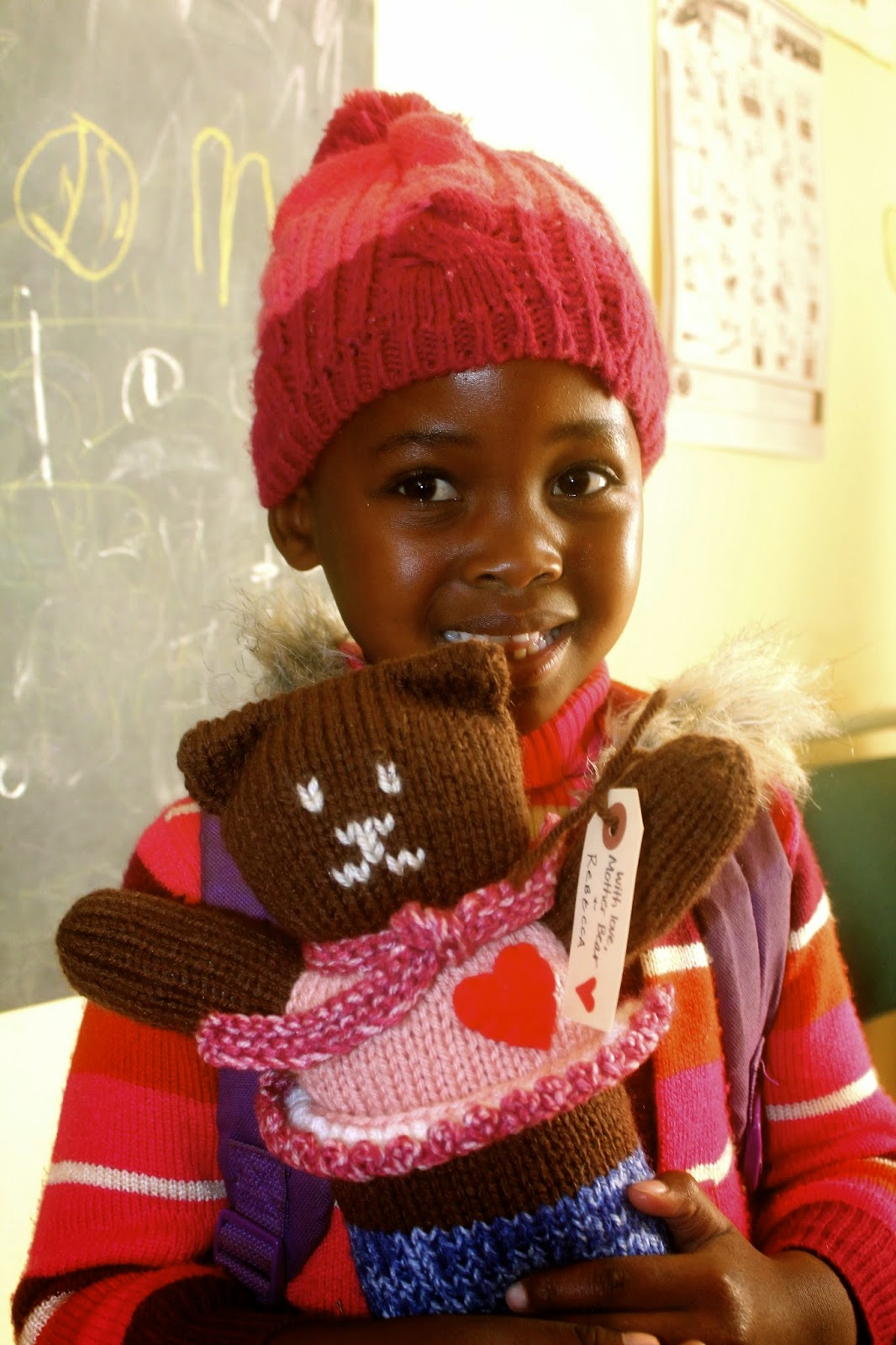 The Mother Bear Project is run out of Minnesota. They send teddy bears to kids, so that they can have a toy that is completely their own and to provide emotional comfort. I gave them out to the kindergarteners at the elementary school, and this girl had particularly pretty smile.