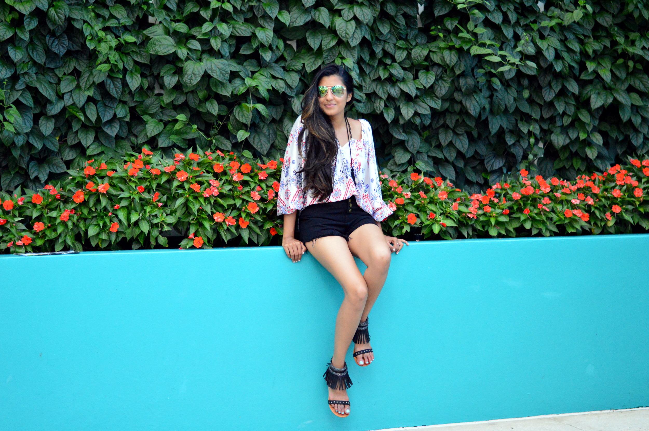 denim-highwaisted-cutoff-shorts-printed-tasseled-peasant-blouse-summer-outfit 1