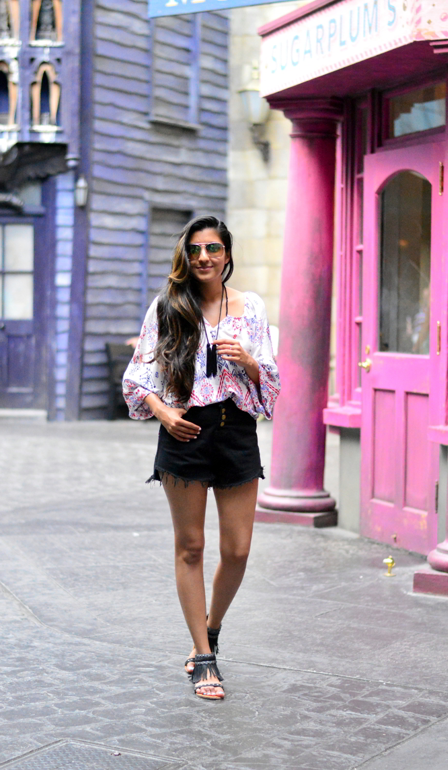 denim-highwaisted-cutoff-shorts-printed-tasseled-peasant-blouse-harry-potter-wizarding-world-outfit 7