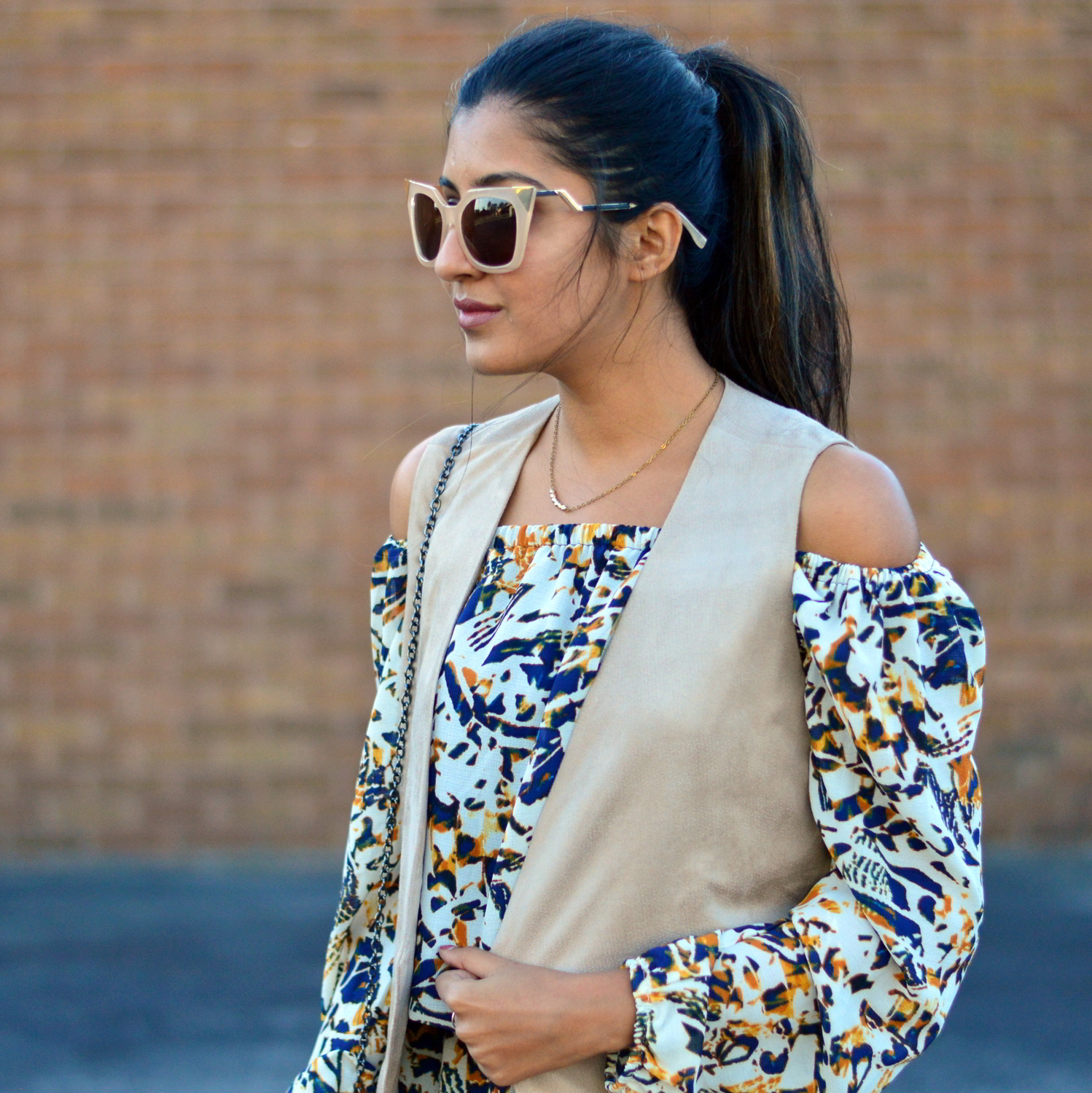 transition-off-the-shoulder-into-fall-suede-vest-romper-statement-sunglasses 6