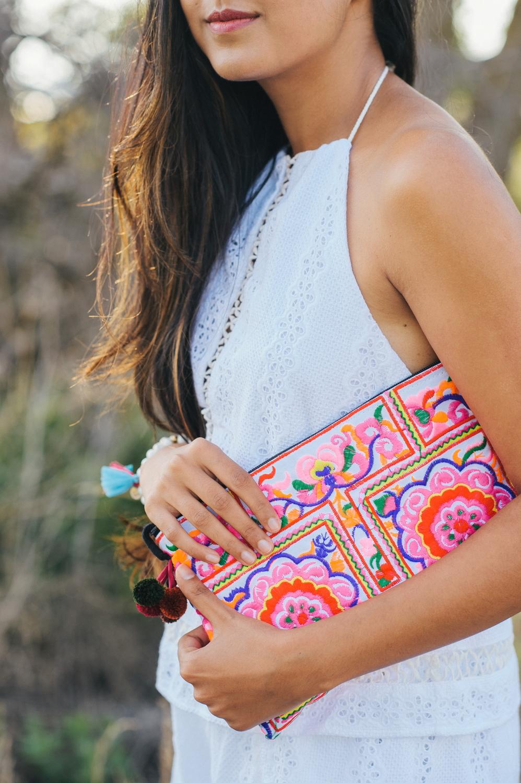little-white-crochet-romper-embroidered-pom-poms-blogger-outfit 4