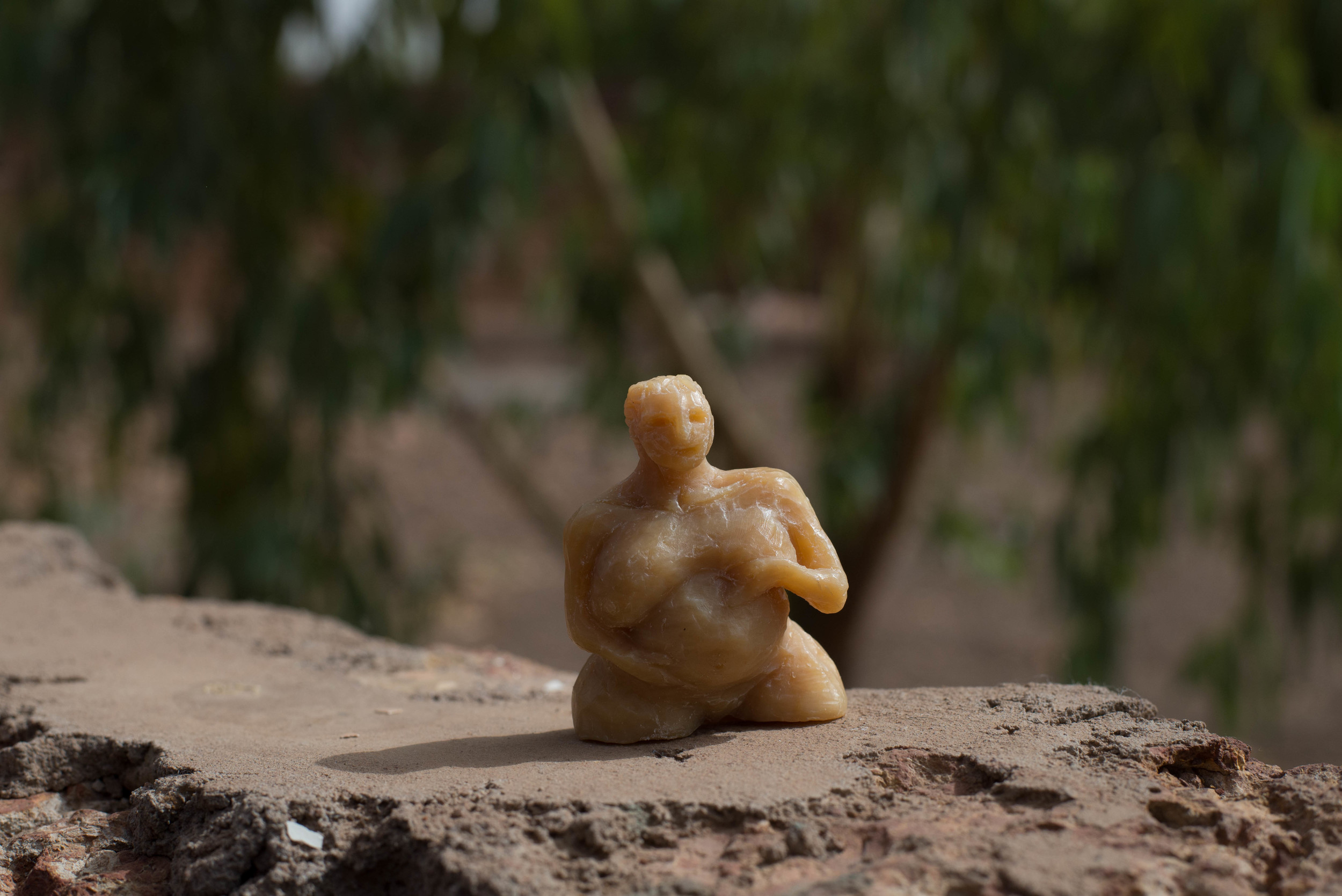 Soap figurine of a pregnant woman. There are at least four pregenant women in my neighbor's family compound, so after I carved this and gave it to their family.