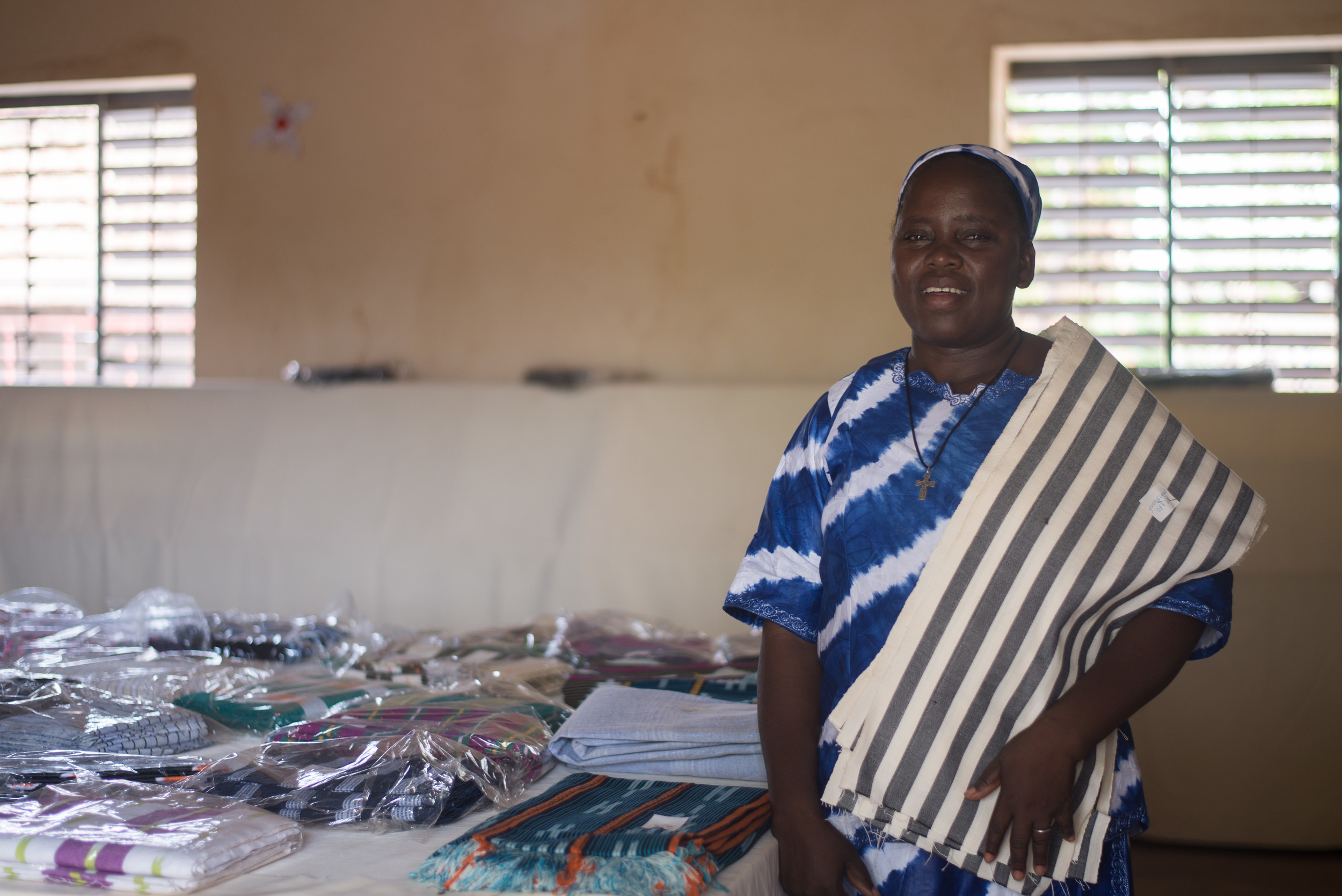 Sister Marie showing off some of the hand woven pagne made by the girls made during the year.