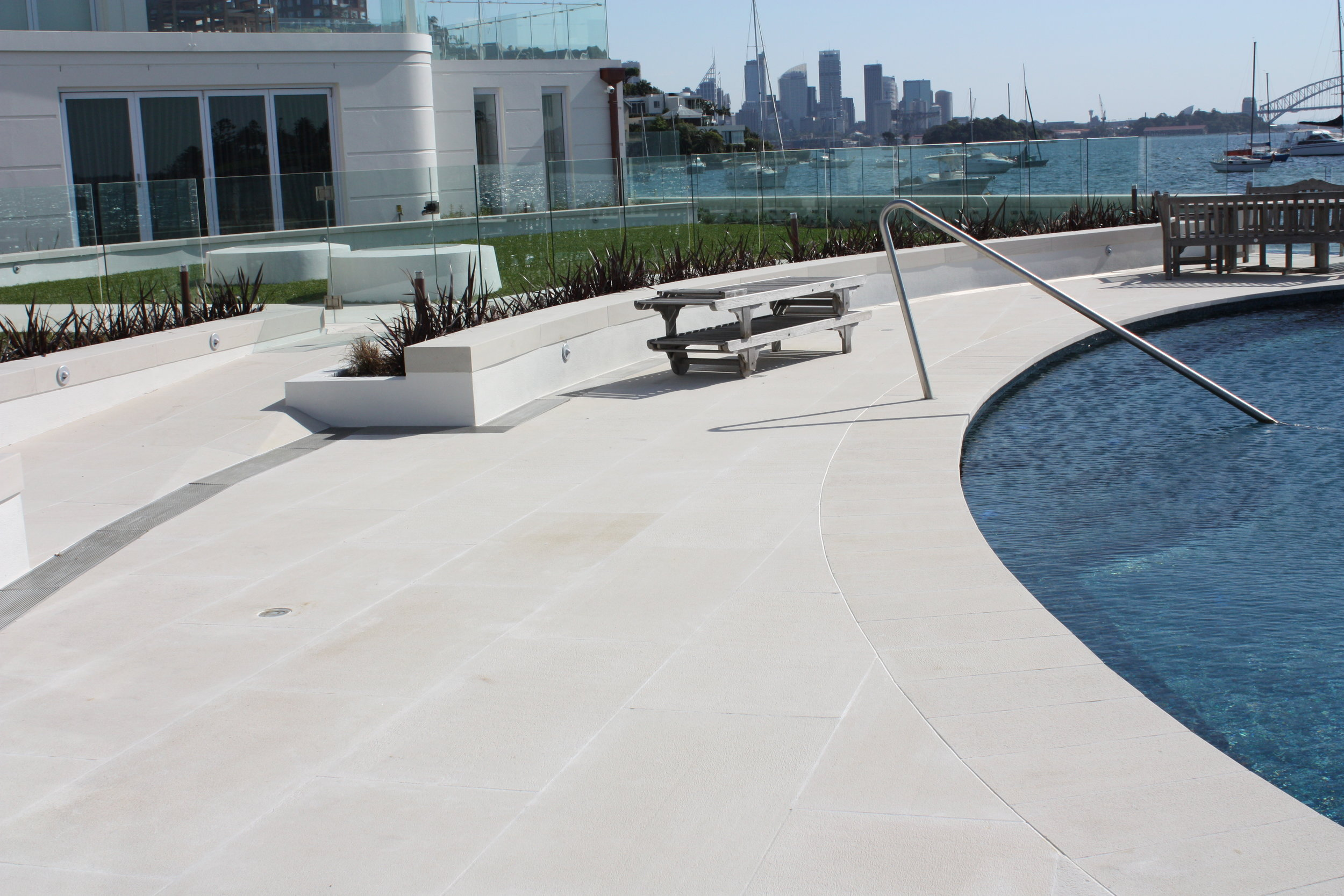 MTW Pure White Gangsawn paving with Bullnosed pool coping