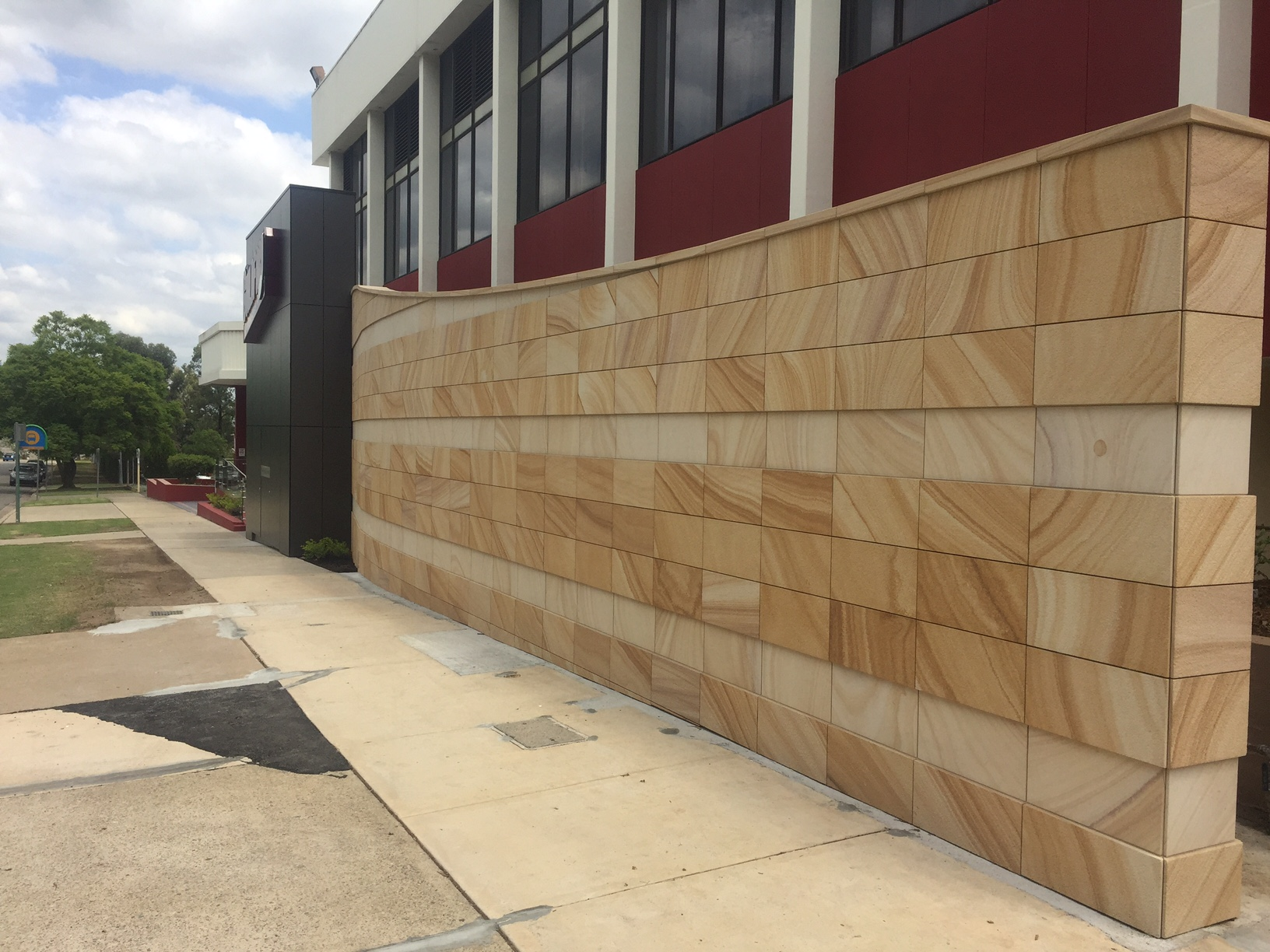 Guilford leagues club medium brown sawn cladding sawn capping birdsmouth joint - elite stonemasons  (2).JPG