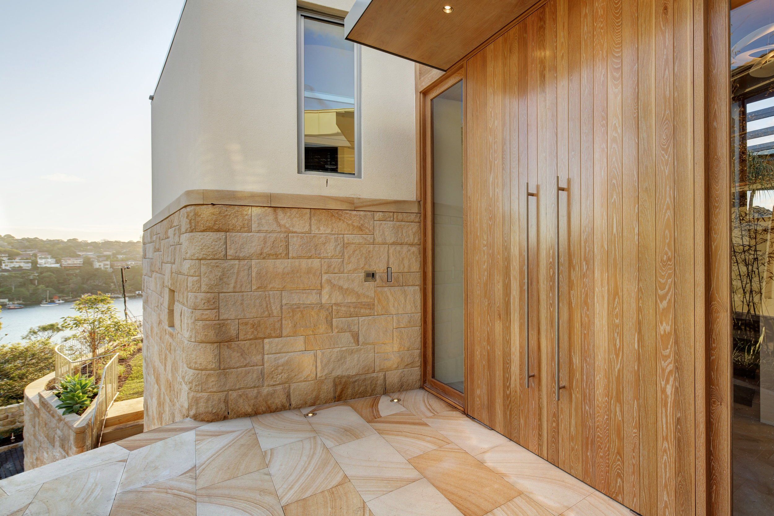 BAY STREET HOUSE MOSMAN light brown random square rockfaced cladding curved walling artistry in stone (7).jpg