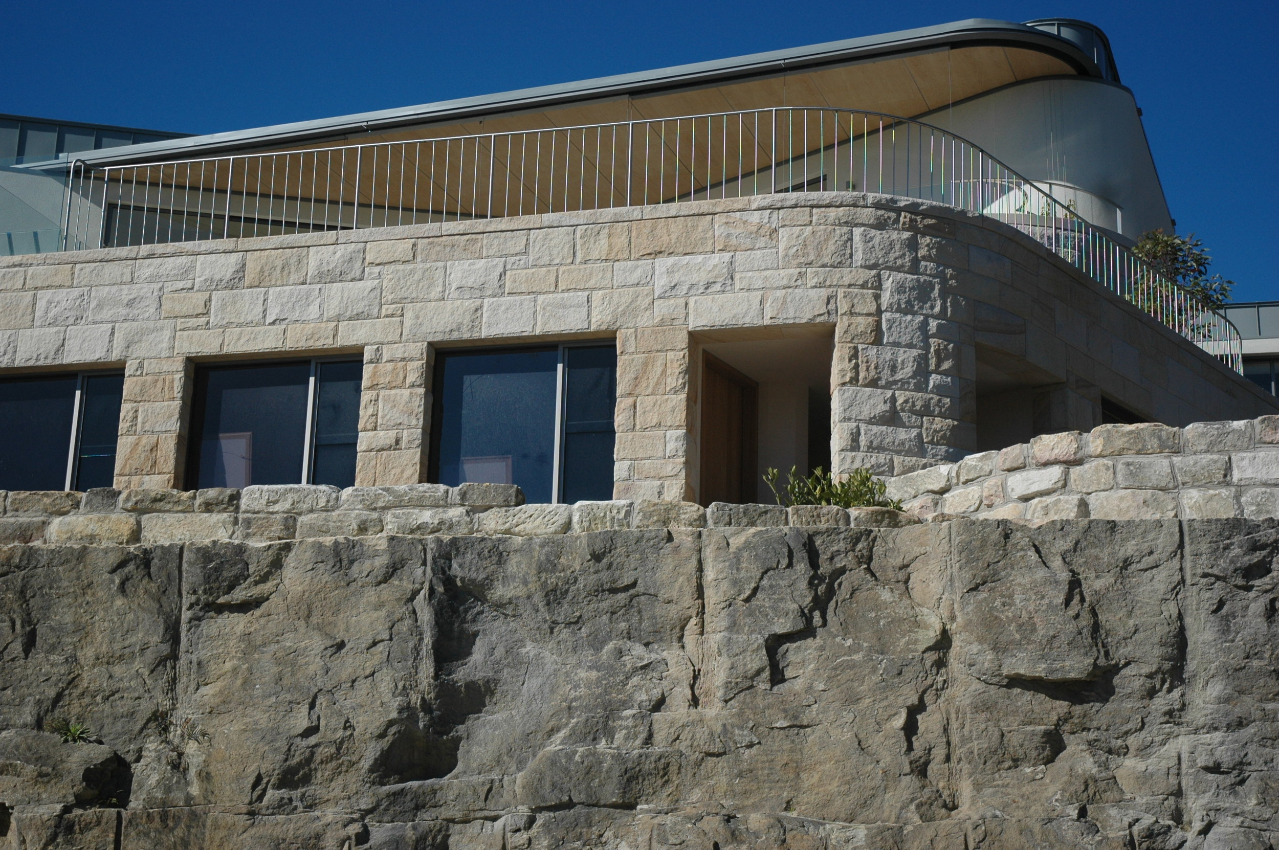 white-very light brown select- Random Square ballast cladding with curved detail - cliff face view - Artistry in sandstone.JPG