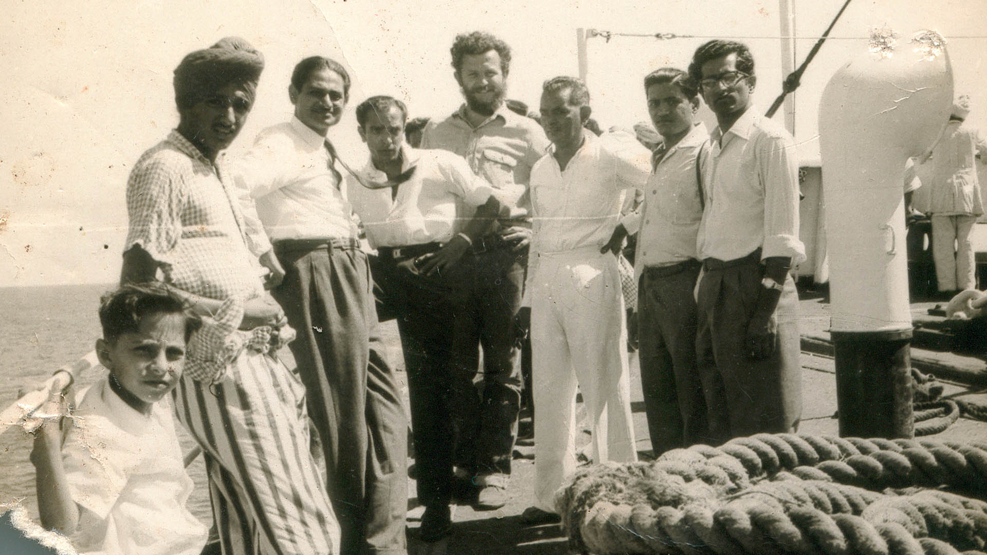 Alfred on ship with Indian men copy.jpg