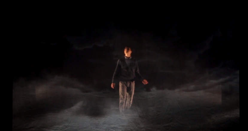 A mixture of real and simulated smoke and clouds in a performance of Song for Terrance 2015