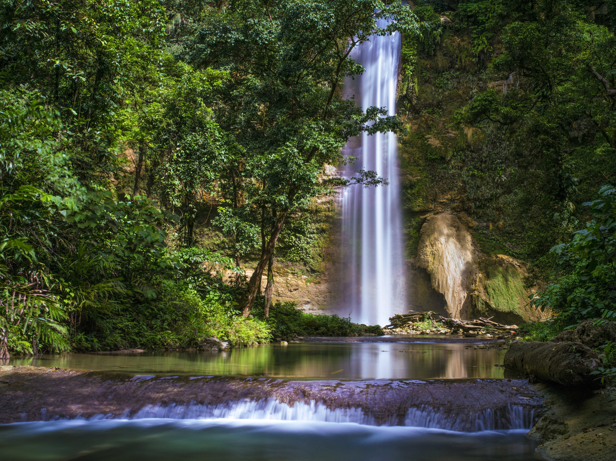 Tenaru Waterfall Tour - 6 HoursYour tour guide will collect you from your hotel or rest house and travel east, past Henderson Airfield over Alligator Creek through Tenaru Village to the spot that you will begin the walk to the Waterfall. The local guide and custom land owner will point out many interesting points of interest and wildlife along the half an hour walk to the beautiful waterfalls were you can swim and enjoy the picturesque landscape. If you are willing to adventure further, you can walk another 30 minutes to a cave with Bats and custom drawings. This adventure is a must on Guadalcanal.1 Person $184 AUD PP2- 4 People $160 AUD PP5 + People $140 AUD PP*Please Note: This tour is suitable for those with a reasonable level of fitness and are able bodied, as there is substantial about of walking on rocky terrain.