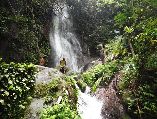 People Trekking standing infront Waterfall - small.jpg
