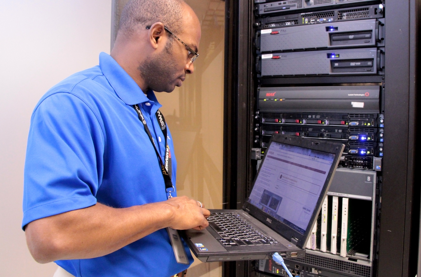 Brian Hall, an expert technician at Continuant, configures an Avaya phone system