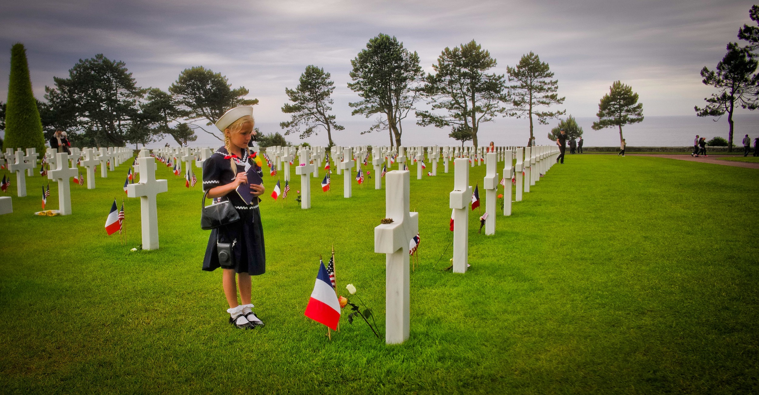Virginia writes down the names of our fallen heroes at Omaha Beach Cemetery.