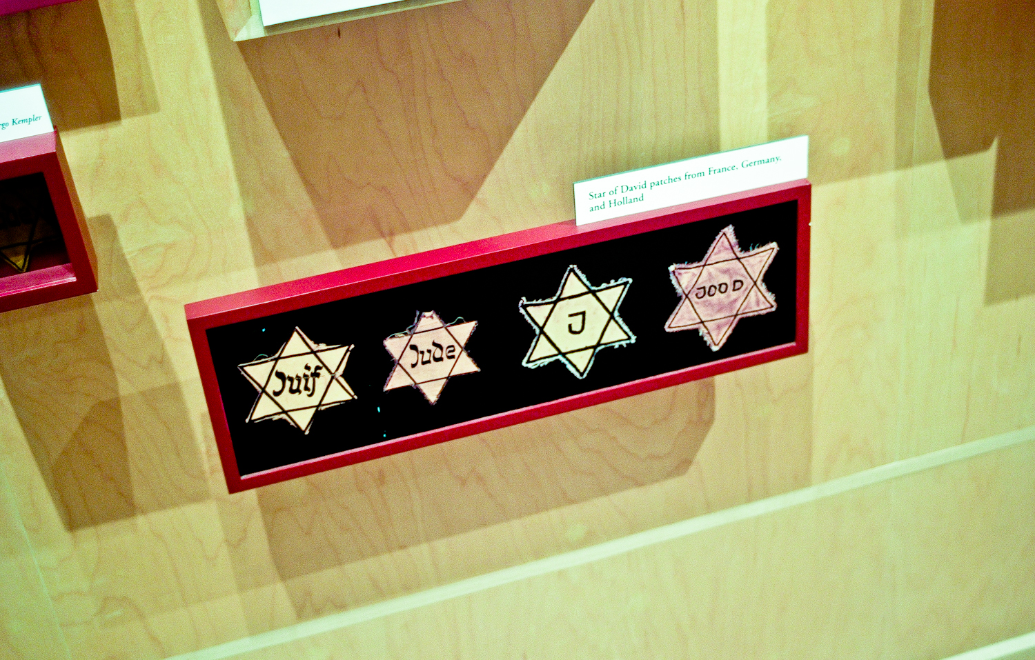 Various versions of the Star of David that was required to be worn by all Jews.