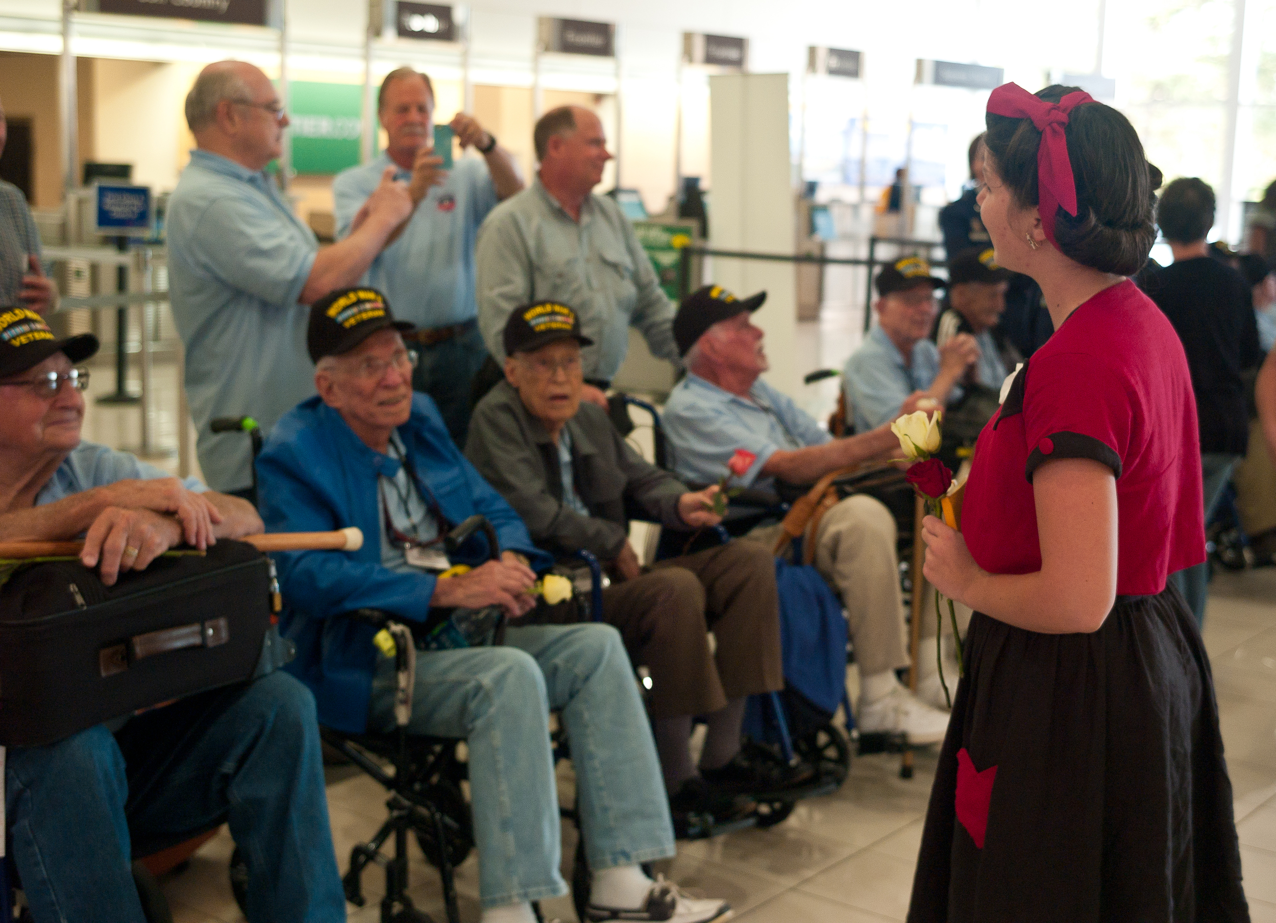 Faith had the wonderful opportunity to go down the line of veterans singing their favorite songs while they waited for the bus to take them to their hotel.