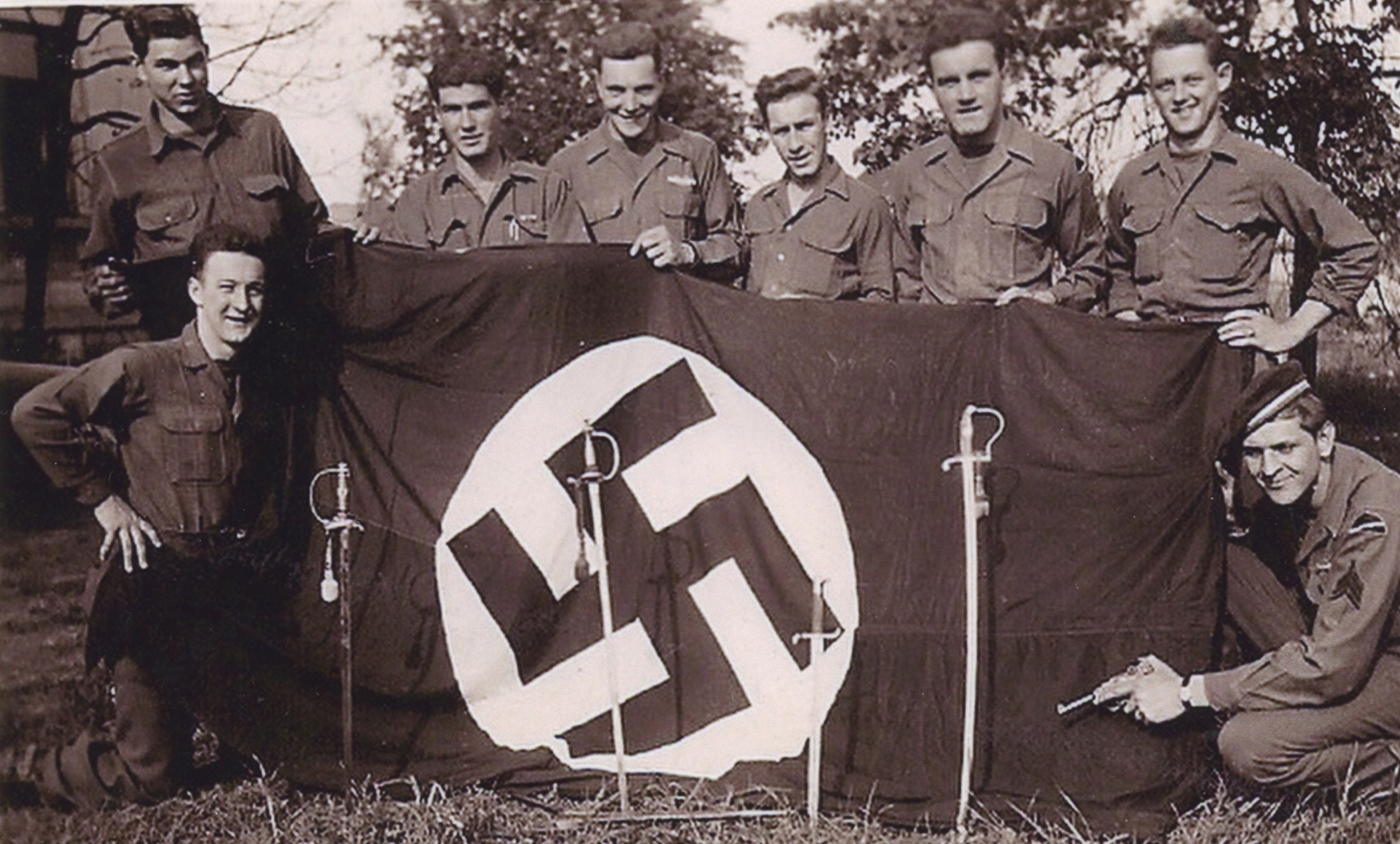 Mr. Zemont far right, kneeling with German Luger. May, 1945, Waldeck, Germany.