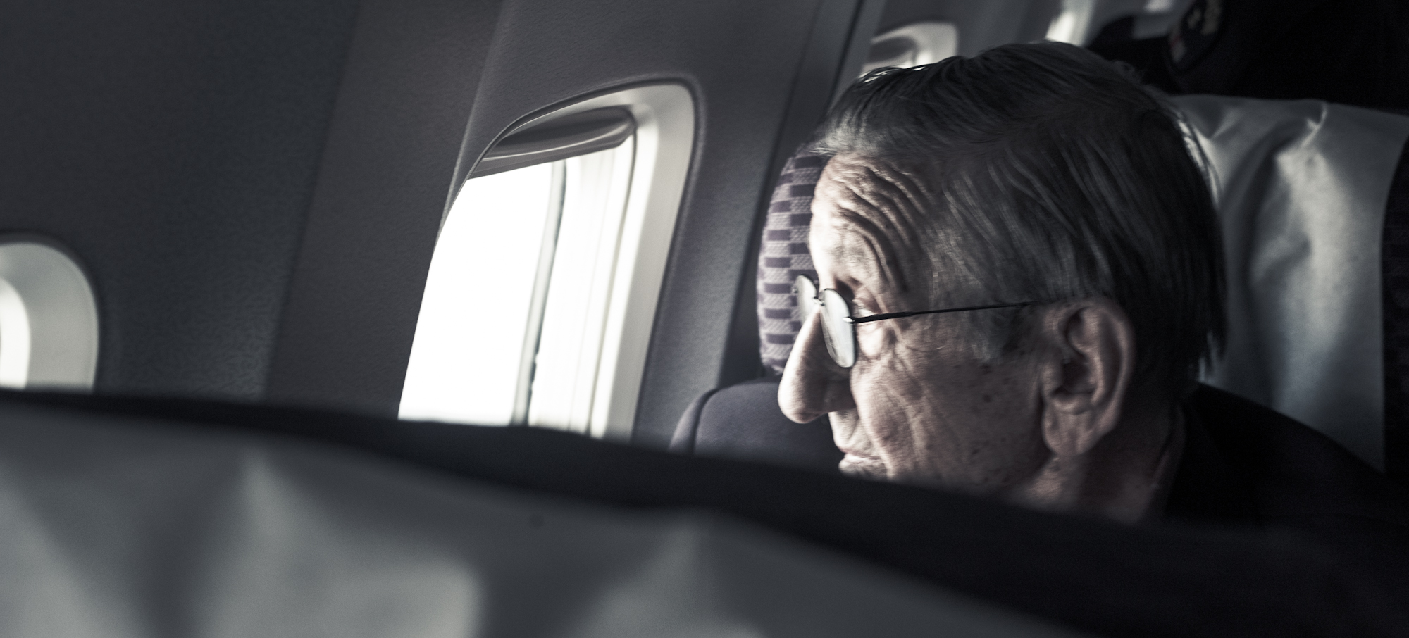 Mr. Pontisso looks out the window as we circle Iwo Jima, moments before landing.