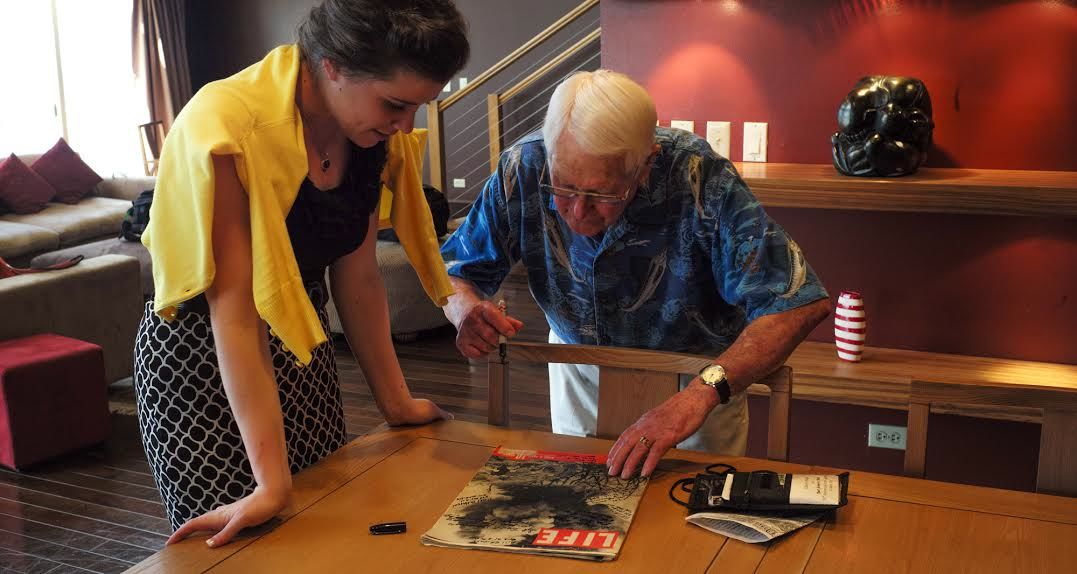 Mr. C. Burney signs my LIFE magazine. The cover depicts a blockhouse being blown up on Iwo Jima.