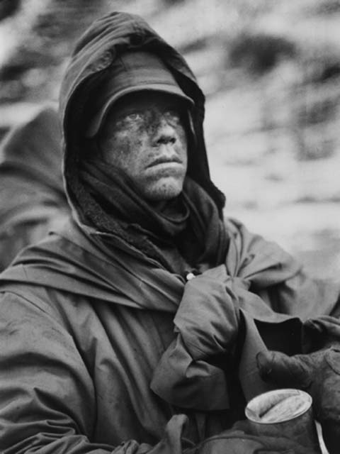 """One of the most iconic photos from the Chosin Reservoir Campaign. """"A dazed, hooded Marine clutches a can of food during his outfit's retreat from the Chosin Reservoir during the Korean War, December 1950"""". Photo by David Douglas Duncan"""