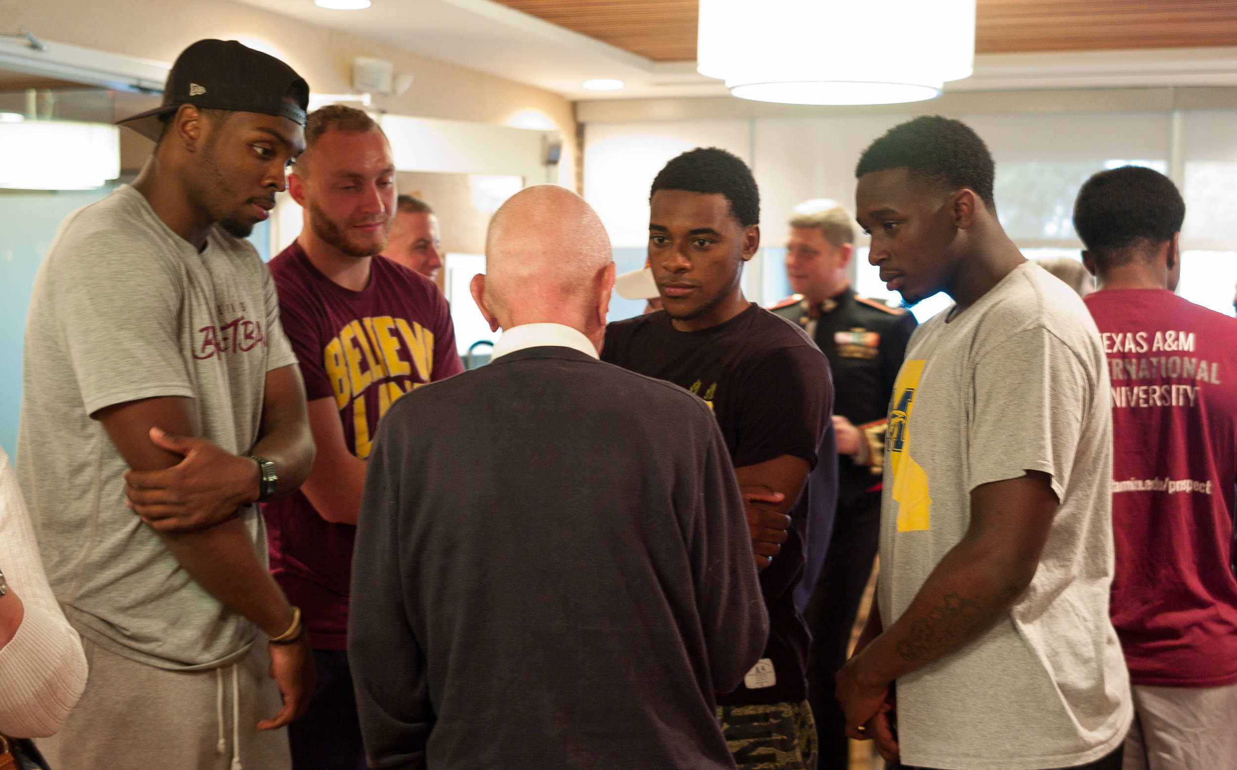 Jerry Yellin, P51 pilot, telling stories to a few fellows from the basketball team that was staying at our hotel.