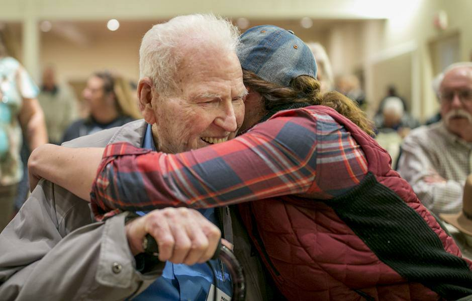 Hugs for one of my favorite Pearl Harbor vets, Jim Leavelle.Photo Credit: Austin-American Statesman
