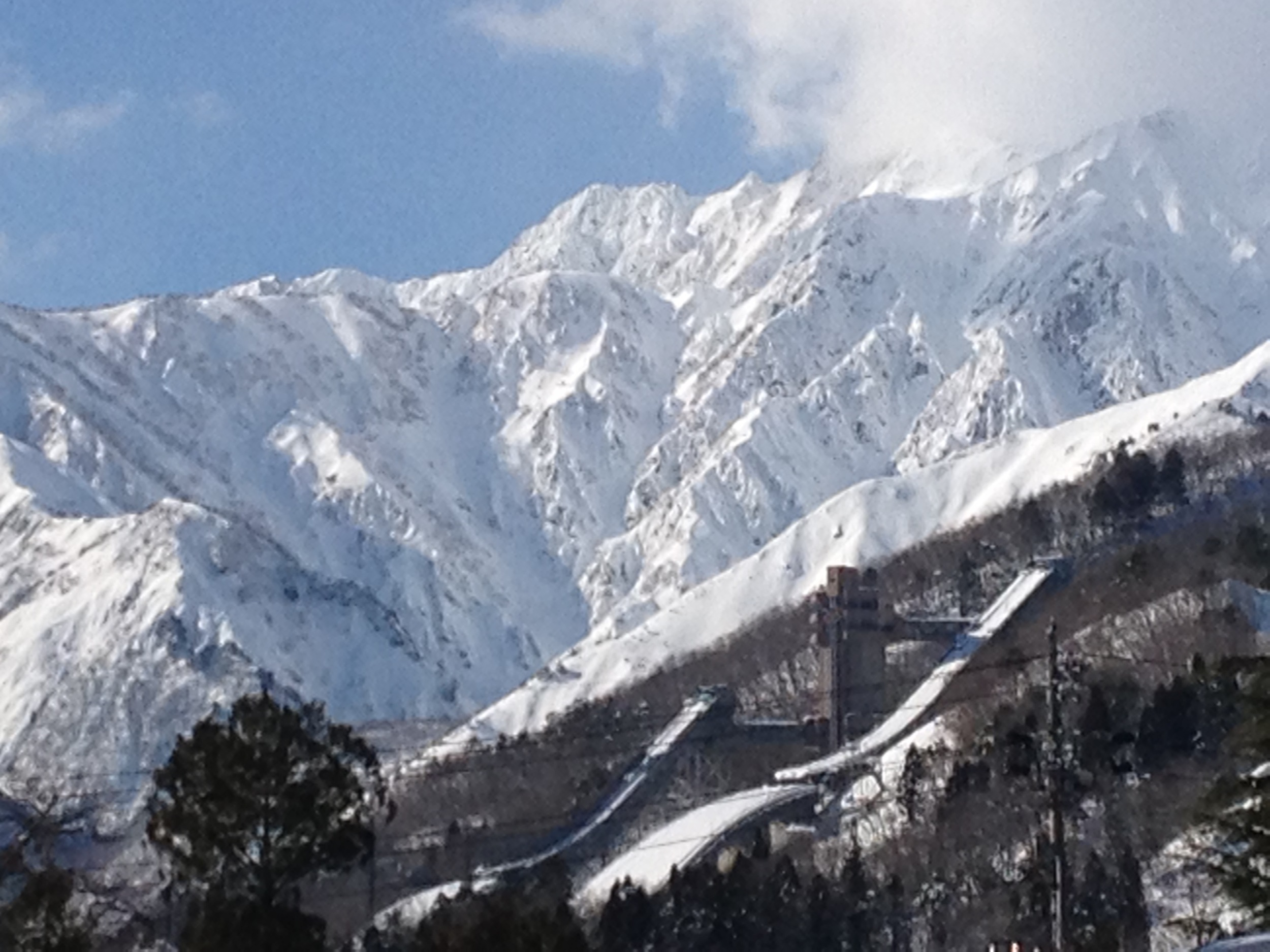 Impressive backdrop of the Japanese Alps, looming over the village of Hakuba