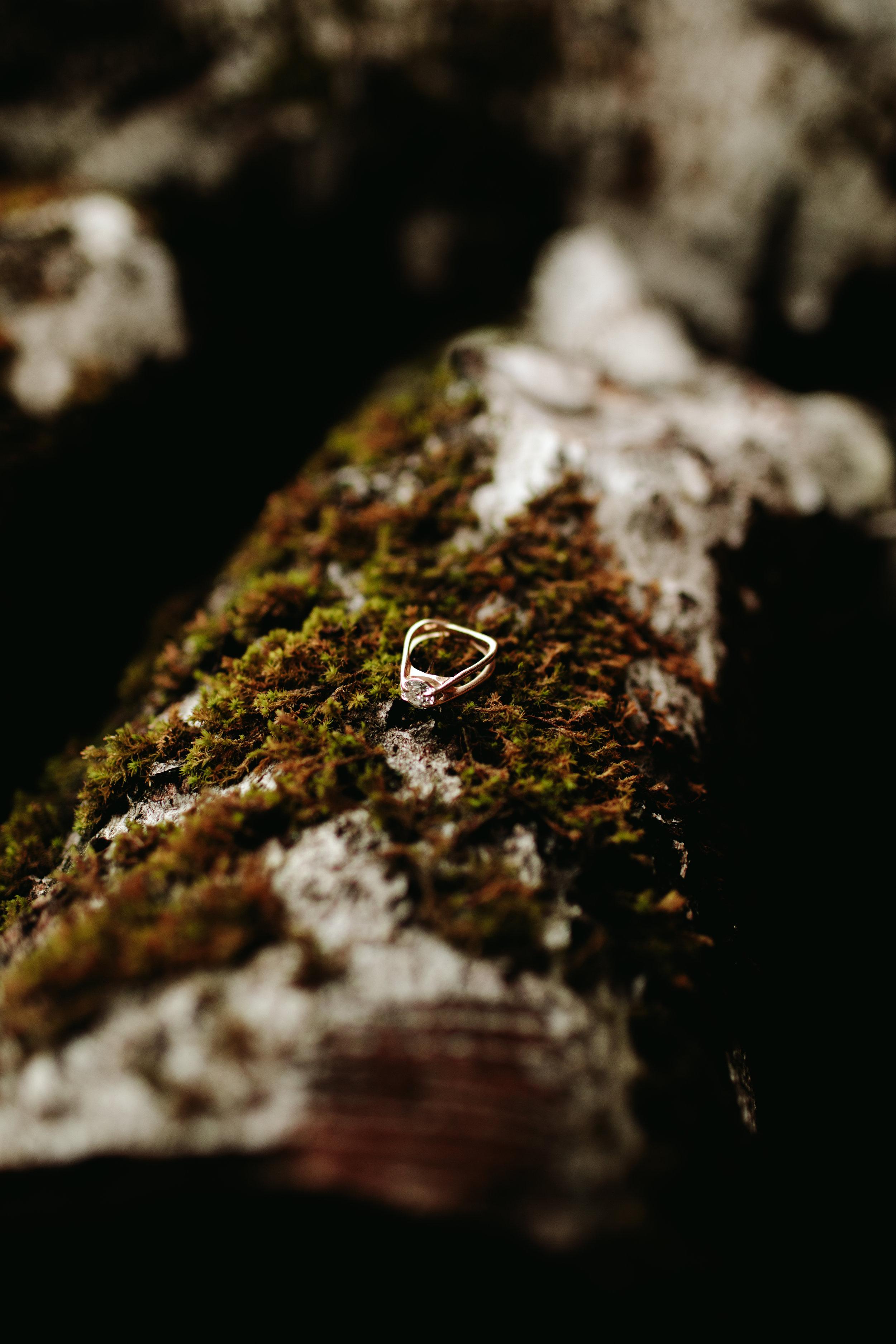 wedding-ring-on-moss