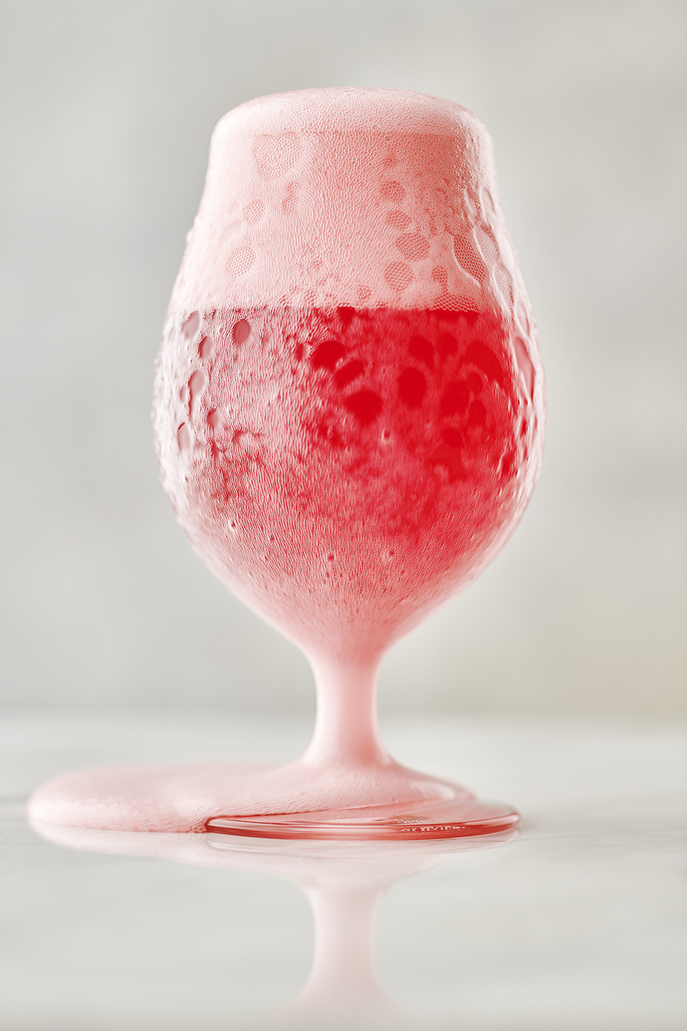 Overflowing Glass of Raspberry Beer