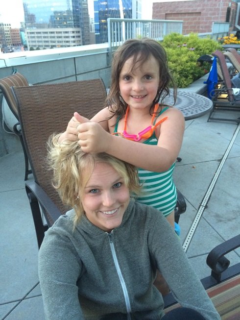 Elle styling Marisa's hair