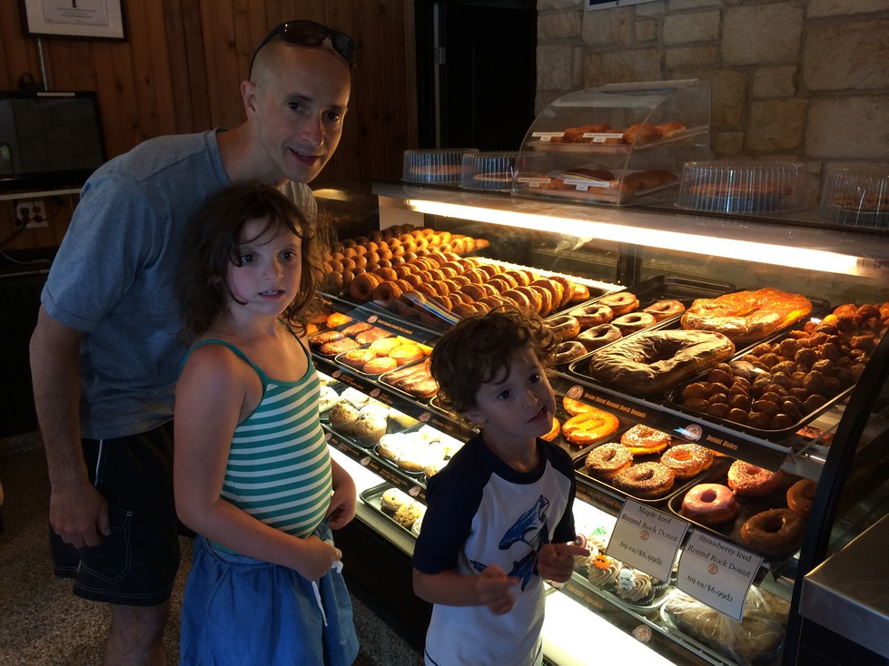 Yes, that is a donut in the case beside Tag's head. No, we did not get one, but Tag tried.