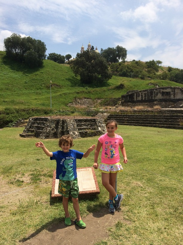 The plaque behind Tag said they used to sacrifice small kids on the stone structure (for real)....so we had the kids pose for a pic