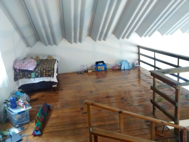 Elle's bed and play area in the loft