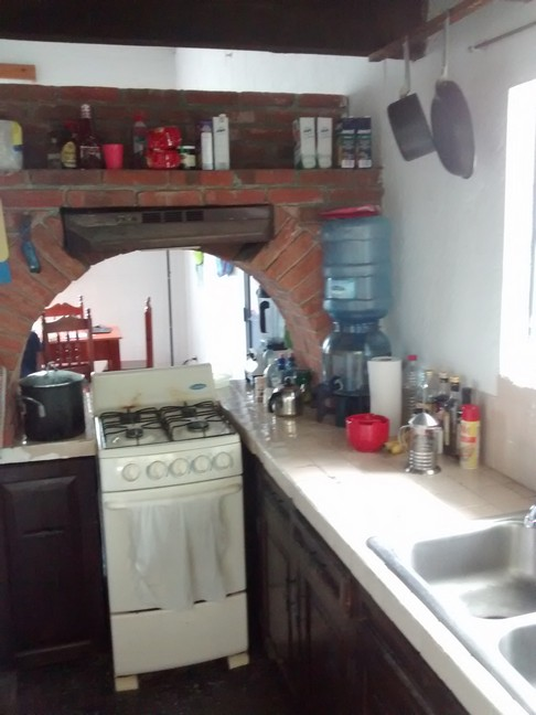 The kitchen is small but works