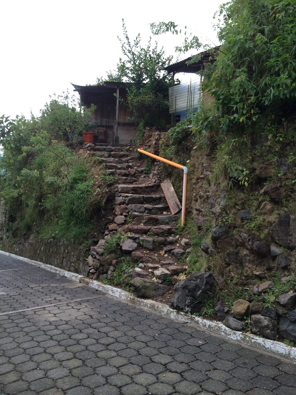 Although we took this trip two months ago, this image has stayed with me. This is someone's walkway. The house may be decrepit and pieced together with recycled materials, but their view of Lake Atitlan is breathtaking.