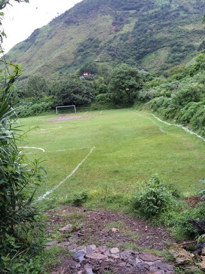 The soccer field was full of rocks and holes.